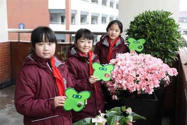爱绿护绿 共建美丽校园——海亮小学植树节活动